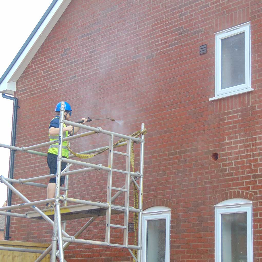 Pressure Washing Brick Wall